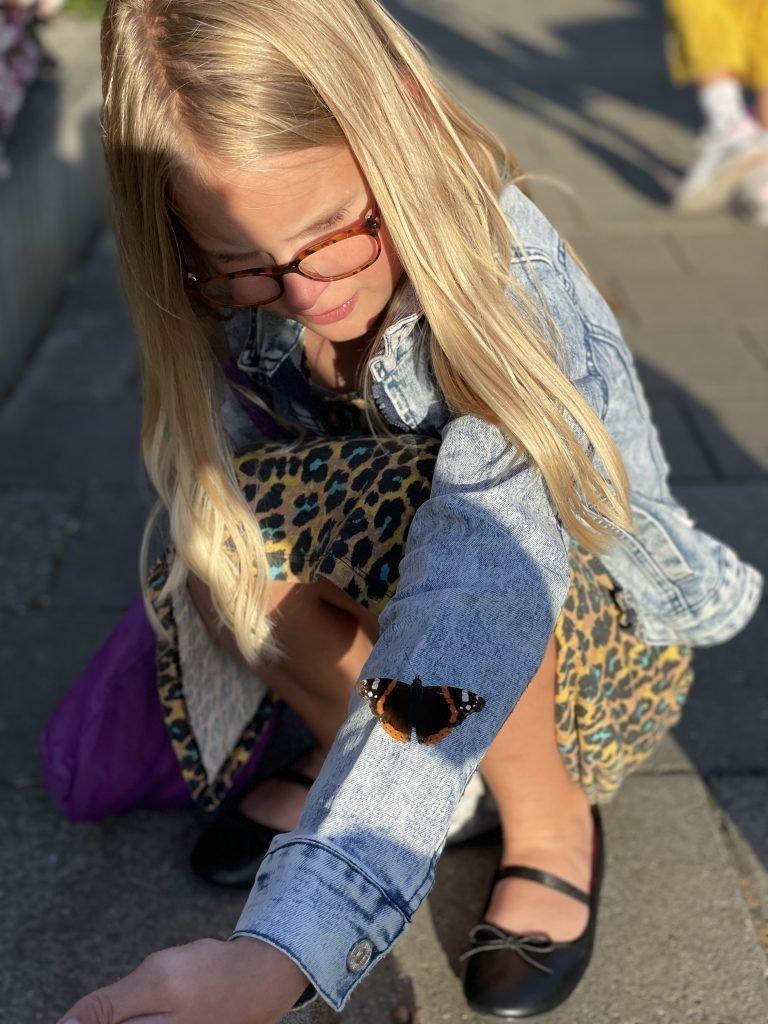 vlinder op de arm